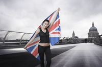 Olympic competitor with union jack in front of st paul s cathedral in london