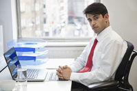 Portrait of a confident businessman at office desk