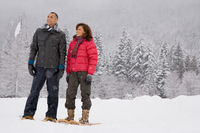 Portrait of a mature couple wearing snowshoes