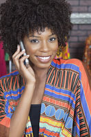 Portrait of an african american female fashion designer on phone call