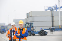 Portrait of confident workers standing in shipping yard
