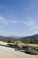 River flowing in front of mountains  jim corbett national park  pauri garhwal  uttarakhand  india