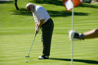 Popular : Senior man putting green