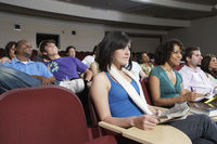 Students sitting in lecture theatre during lesson