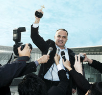 Popular : Successful businessman being interviewed by the press