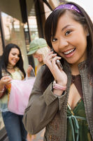 Popular : Teenage girl  16-17  using mobile phone outdoors  portrait