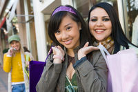 Popular : Teenage girls  16-17  with shopping bags in street  portrait