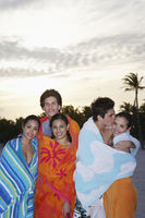 Popular : Teenagers  16-19  wrapped in towels on beach
