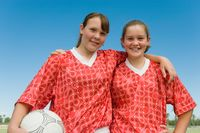 Popular : Two girls  13-17  dressed to play football portrait