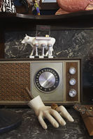 Vintage radio and mannequin hand in second hand store