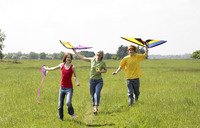 Woman and her children flying kites