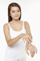 Popular : Woman applying lotion on her hand
