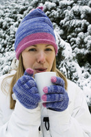 Woman drinking hot beverage  standing outdoor