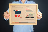 Woman holding board with outlet concept and infographics