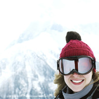 Woman in knitted hat and ski goggles