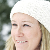 Woman in white knitted hat smiling