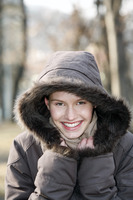 Woman in winter clothing smiling at the camera