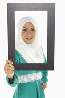 Popular : Woman looking through a cut out frame