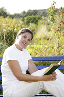 Woman sitting on the bench reading book