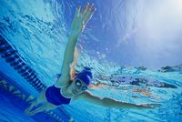 Woman swimming floating underwater  low angle view