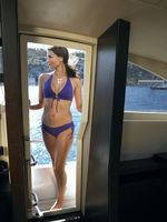 Woman wearing bikini on yacht