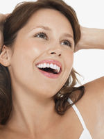 Young brunette woman laughing close up head shot