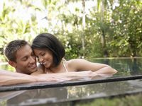 Young couple relaxing in swimming pool