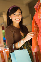 Popular : Young woman in clothes shop  portrait
