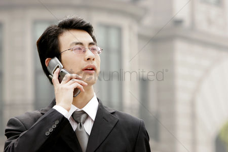 Bespectacled : A bespectacled businessman talking on the hand phone