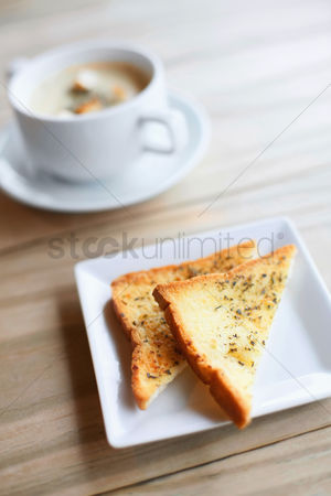 First : A bowl of soup with toast