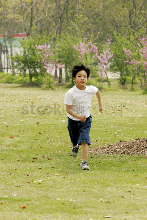 Lively : A boy running in the park