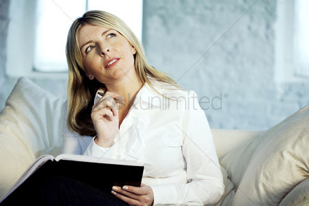 Adulthood : A business lady looking up and thinking