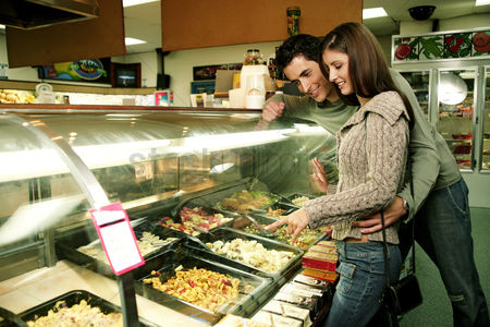 Supermarket : A couple choosing a ready-made food