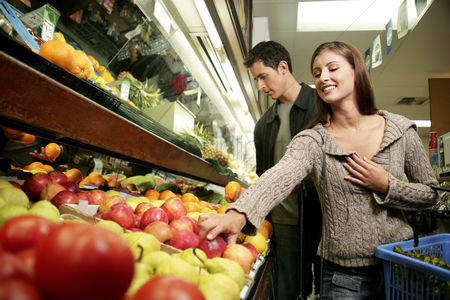 Girlfriend : A couple shopping for fruits