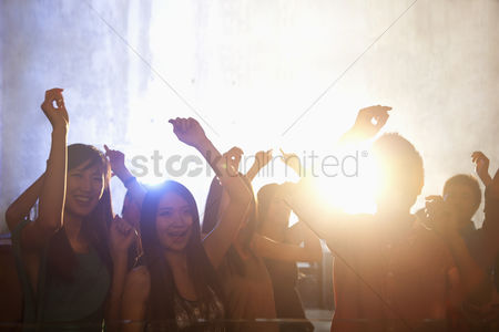 Dance : A crowd of young people dancing in a nightclub