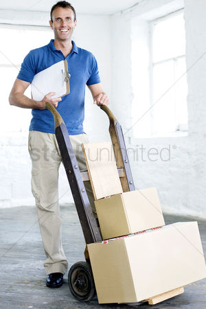 Strong : A delivery man preparing goods for delivery