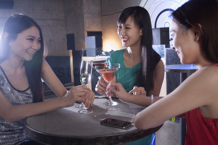 Dance : A group of young women having drinks in a nightclub