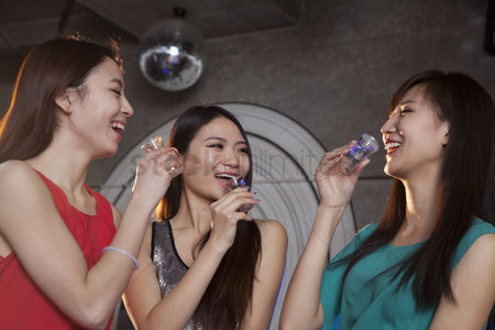 Dance : A group of young women having shots in nightclub