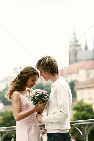 Lover : A guy giving his girlfriend a bouquet of flowers