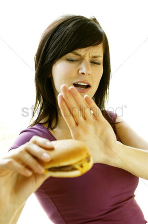 Tasty : A lady refraining herself from eating a cheese burger