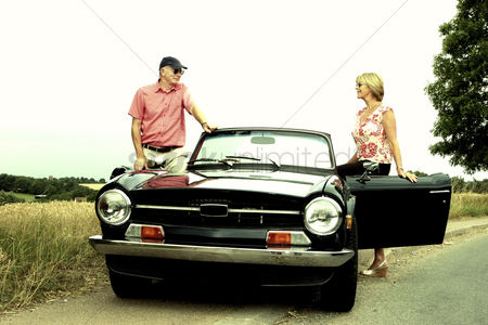 Smile : A man and a woman getting into the car