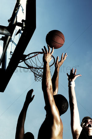 Basket ball : A player trying to shoot the ball into the hoop