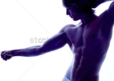 Strong : A shirtless muscular man showing his muscles