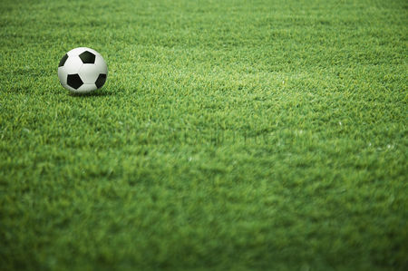 Match : A soccer ball on the playing field