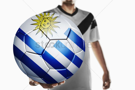 Nationality : A soccer player holding uruguay soccer ball
