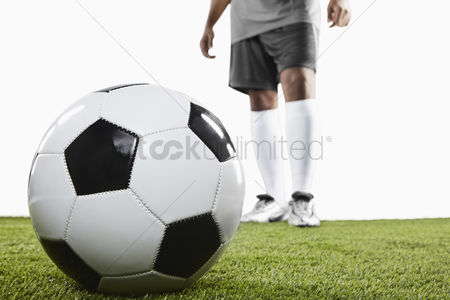 Match : A soccer player ready for freekick