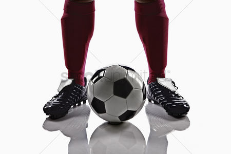 Match : A soccer player with a soccer ball