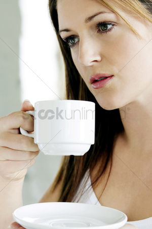Adulthood : A young lady drinking coffee