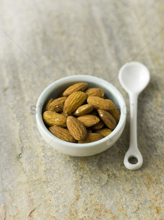 Almond : Almonds in blue bowl with white spoon