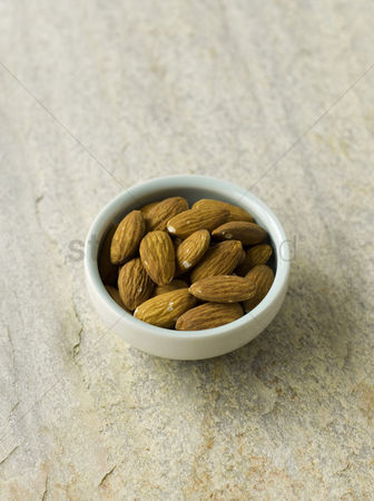 Almond : Almonds in blue bowl